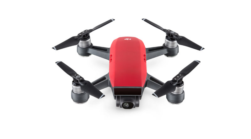 the DJI Spark drone in red , viewed from the front