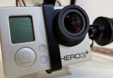 a close up photo of a gopro camera, attached to the gimbal of a cheap drone