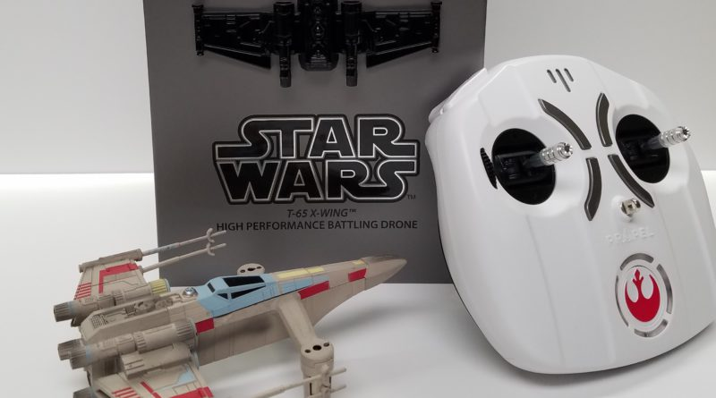 the star wars x wing drone with controller in front of the collector's edition box