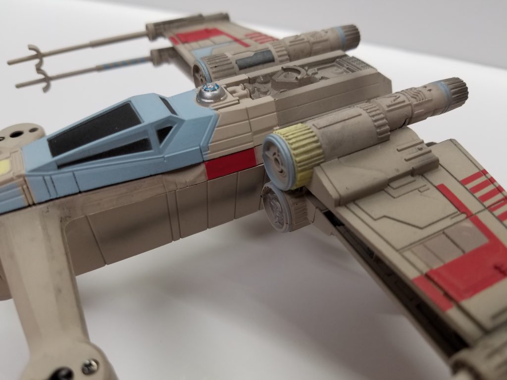 a closeup view of x wing drone from the left